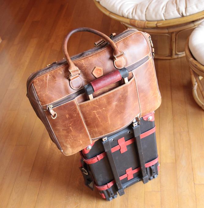 スーツケースにキャリーオン